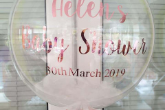 Personalised baby shower balloon. White feathers and rose gold lettering.