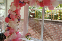 Pretty organic demi arch - available in a variety of colours with added blossoms and foliage